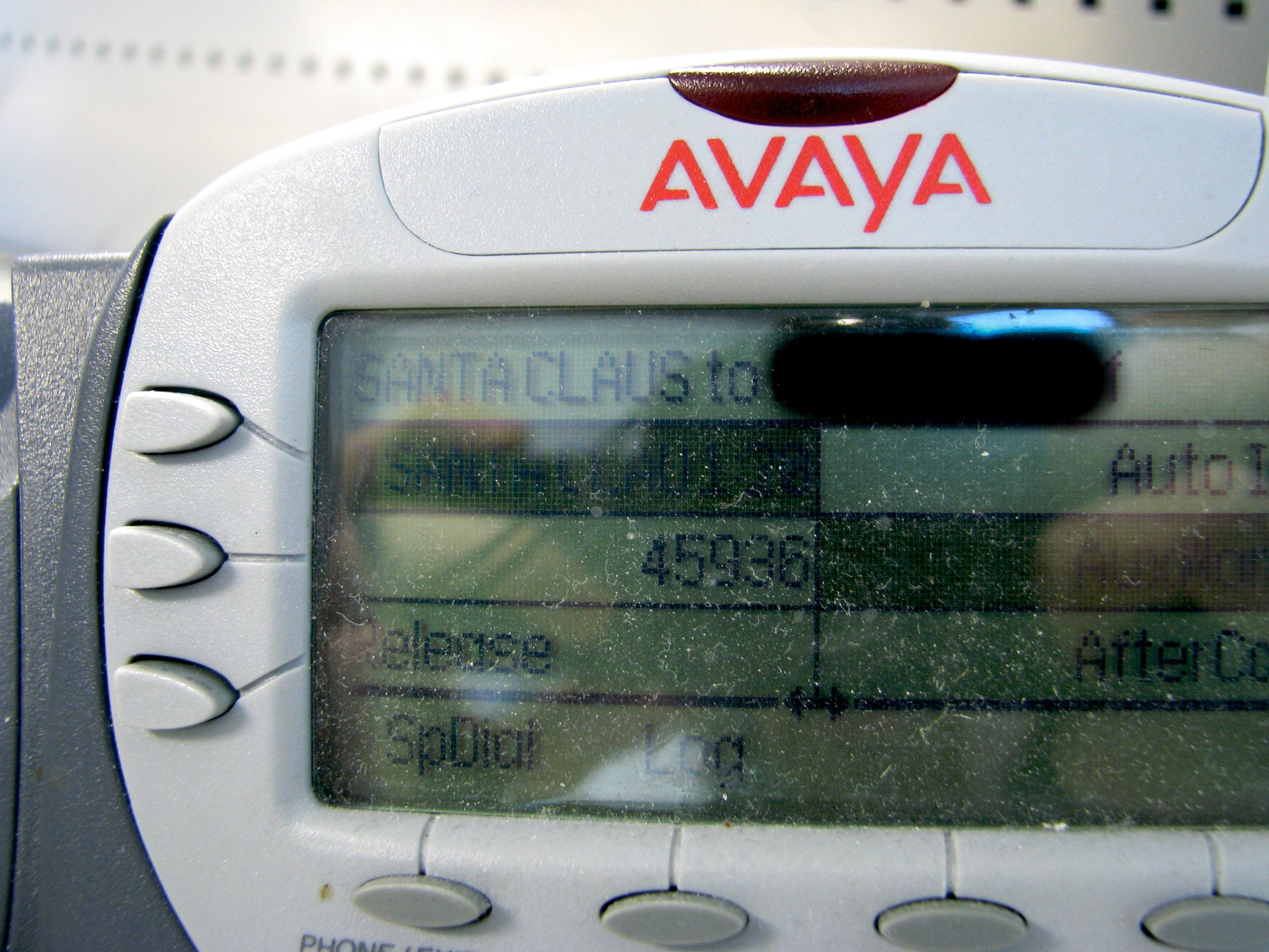 "A closeup of my call centre phone's display saying that I've got an incoming call from ""Santa Claus""."
