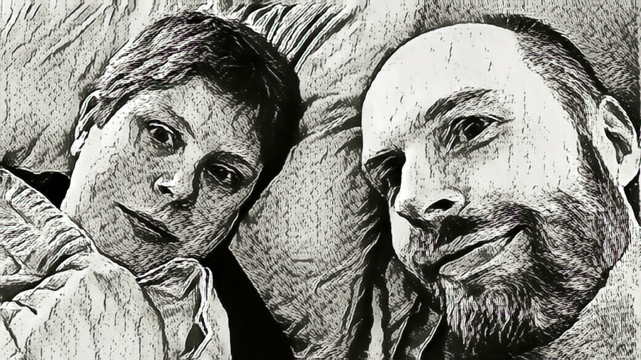 A black and white photo that looks like it's a pencil drawing of me, a white man with a beard, and Kristina, a white woman with short hair, lying in bed on our pillows, smiling at the camera.