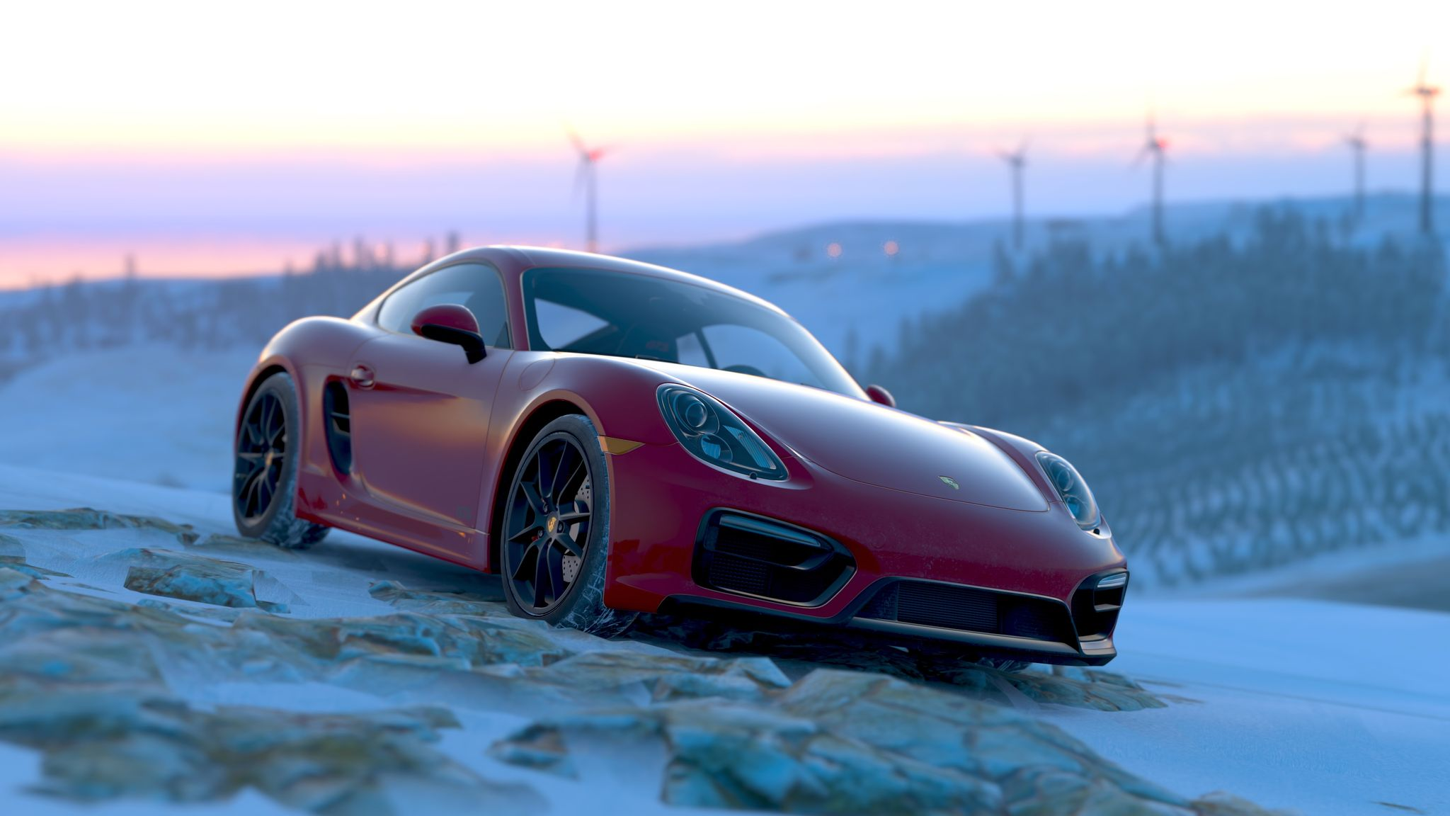 A screenshot that looks more like a photo of a red Porsche (I have NFI what sort, they all look the damn same) sitting on the top of a snowy hill, in the distance and out of focus is the sky just before sunrise, with a number of wind turbines along the hill in the distance.