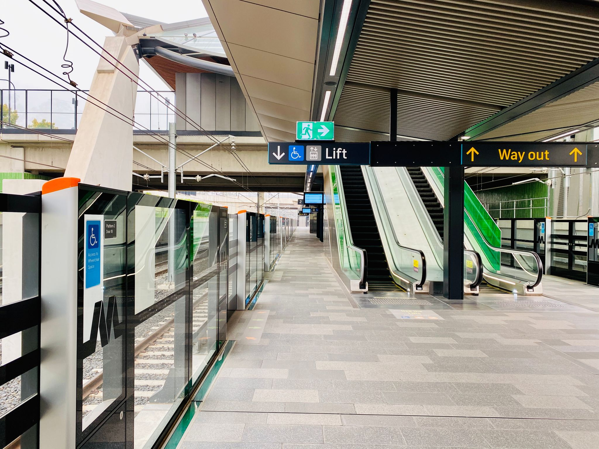 A photo looking down the empty platform of the Sydney Metro at Tallawong.