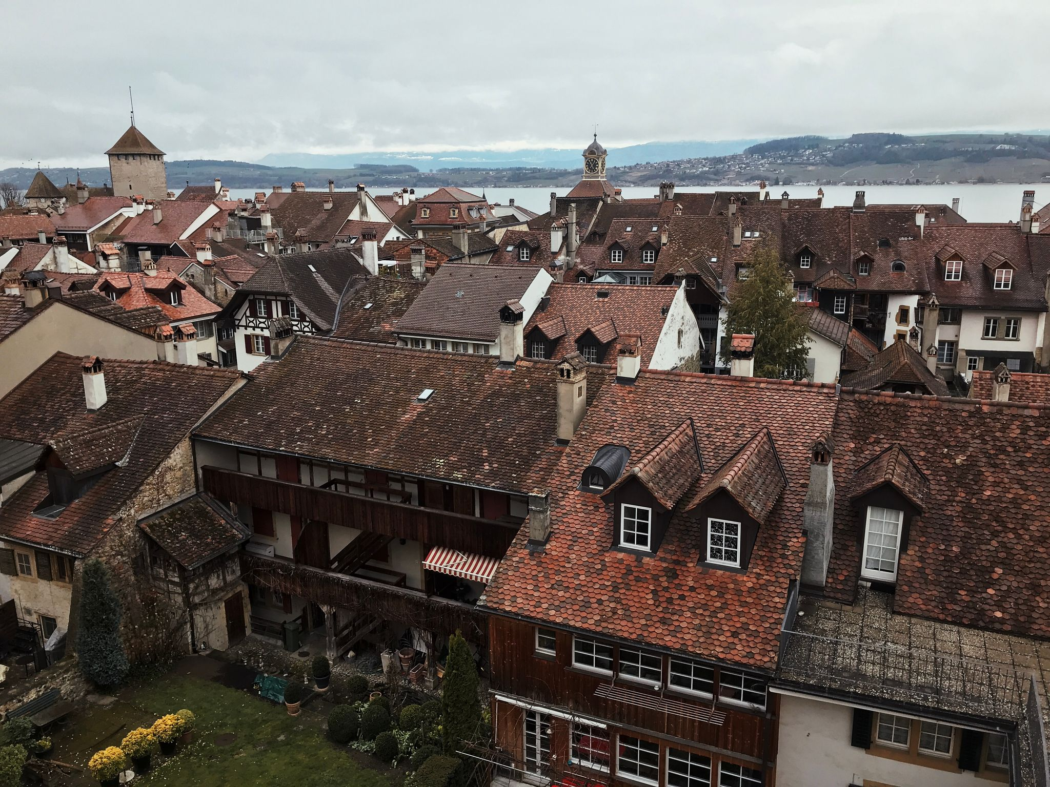 A view looking out over the roofs lots of medieval houses.