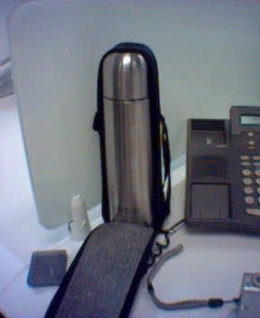 An EXTREMELY poor quality photo from a 2004-era mobile phone of a silver thermos that looks very much like a dildo.