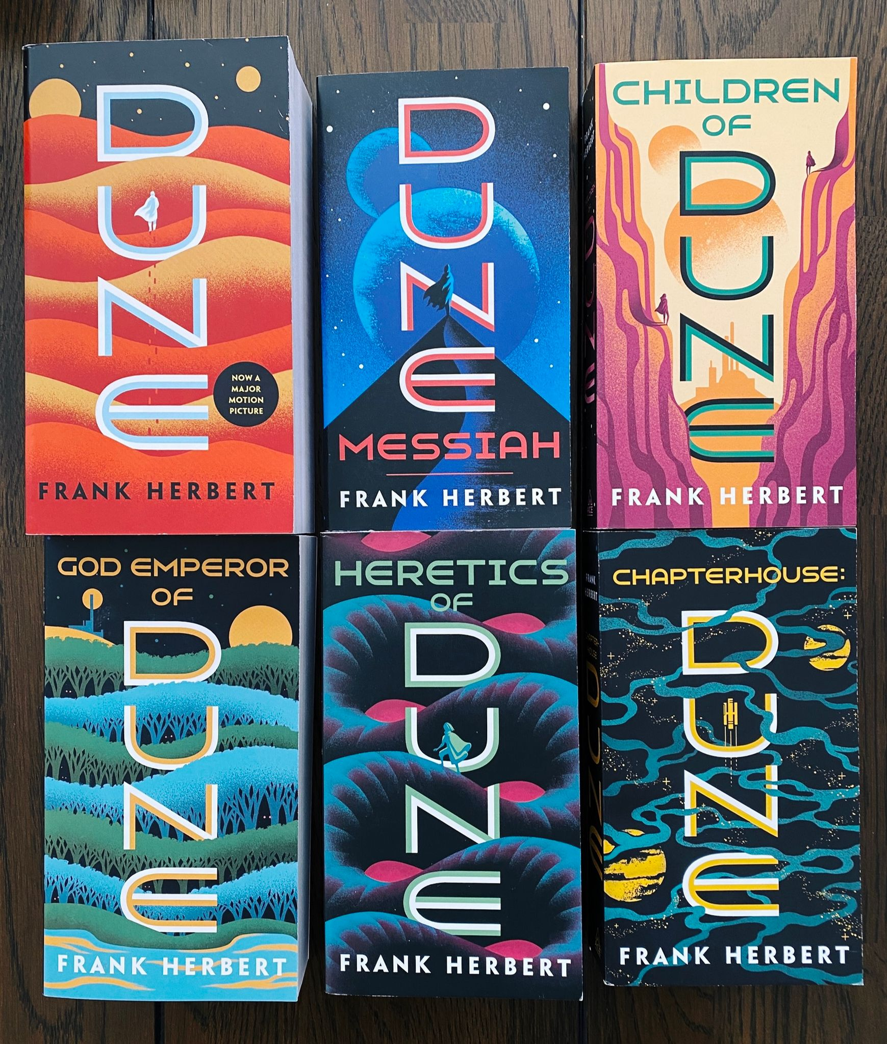 """A photo of the covers of all six of the books in Frank Herbert's """"Dune"""" series."""