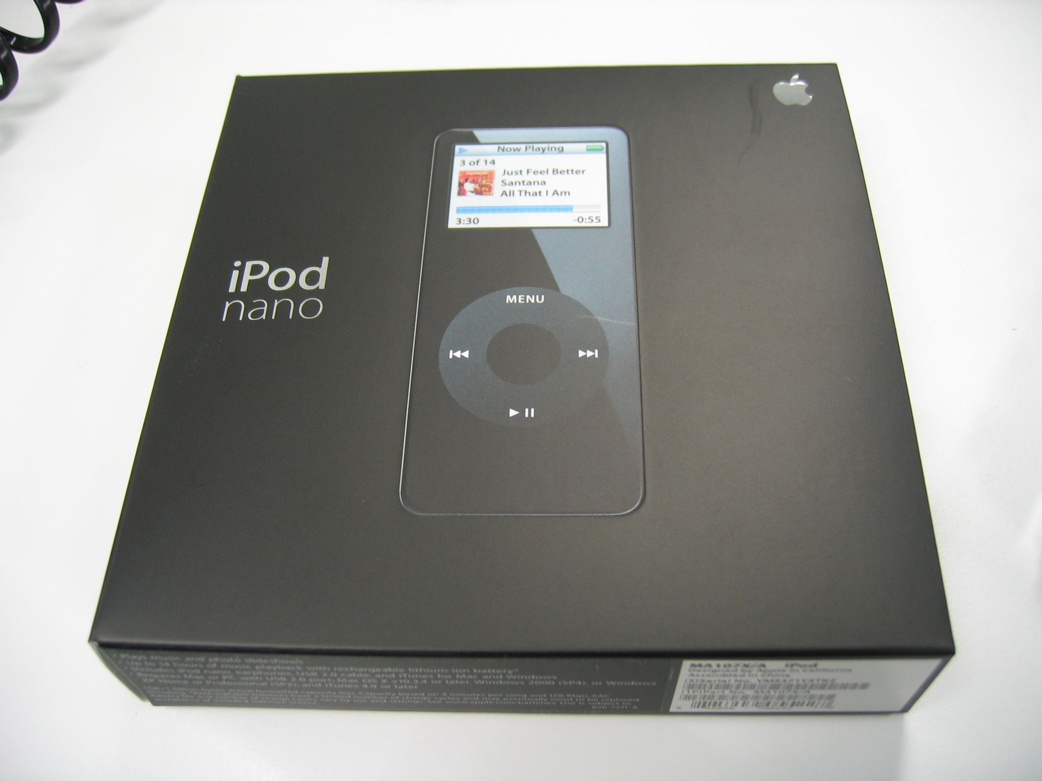 """A photo of the box of an iPod nano. The box black, square, thin, and very minimalist, with just a photo of the iPod nano itself on it, along with the words """"iPod nano"""" in silver next to it."""