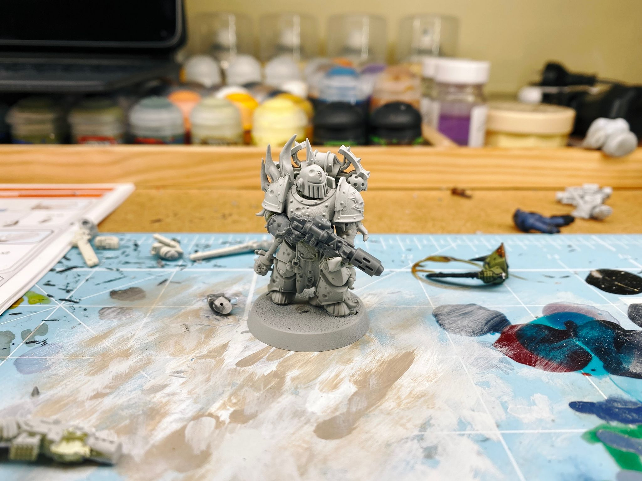 Another Warhammer 40,000 Plague Marine, this one has a tentacle for a left arm and is holding a meltagun. The gun and his right forearm are bare plastic and are the new parts I added.