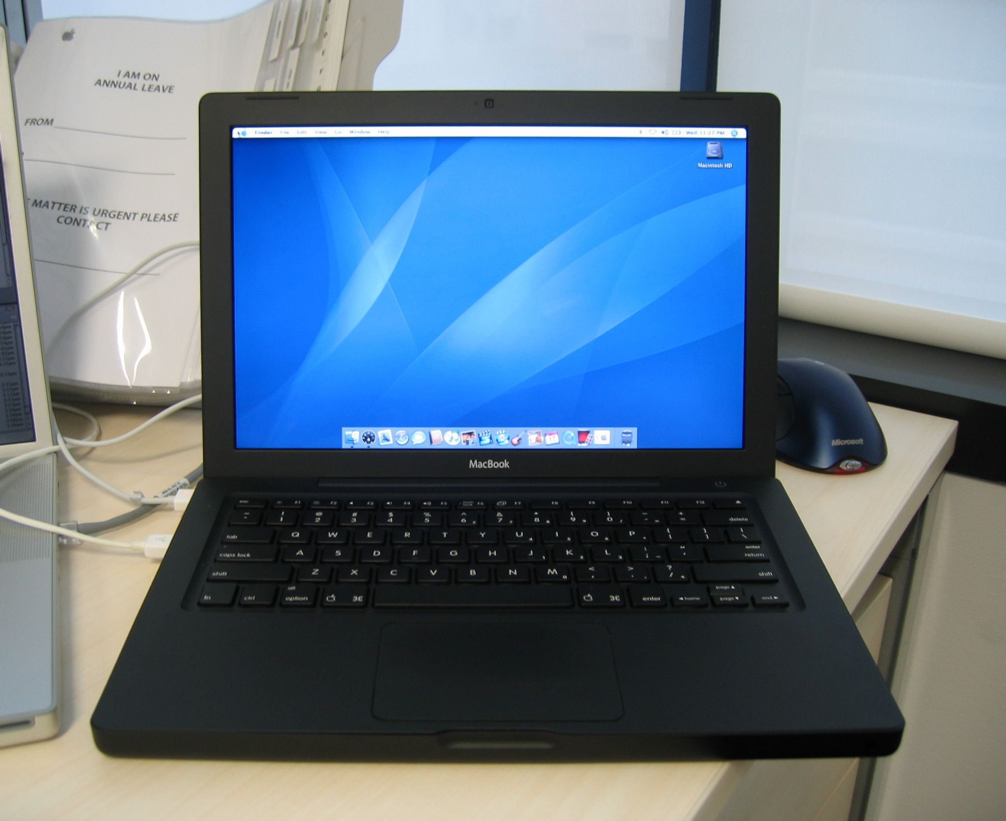 A photo of one of the original polycarbonate MacBooks, in black.