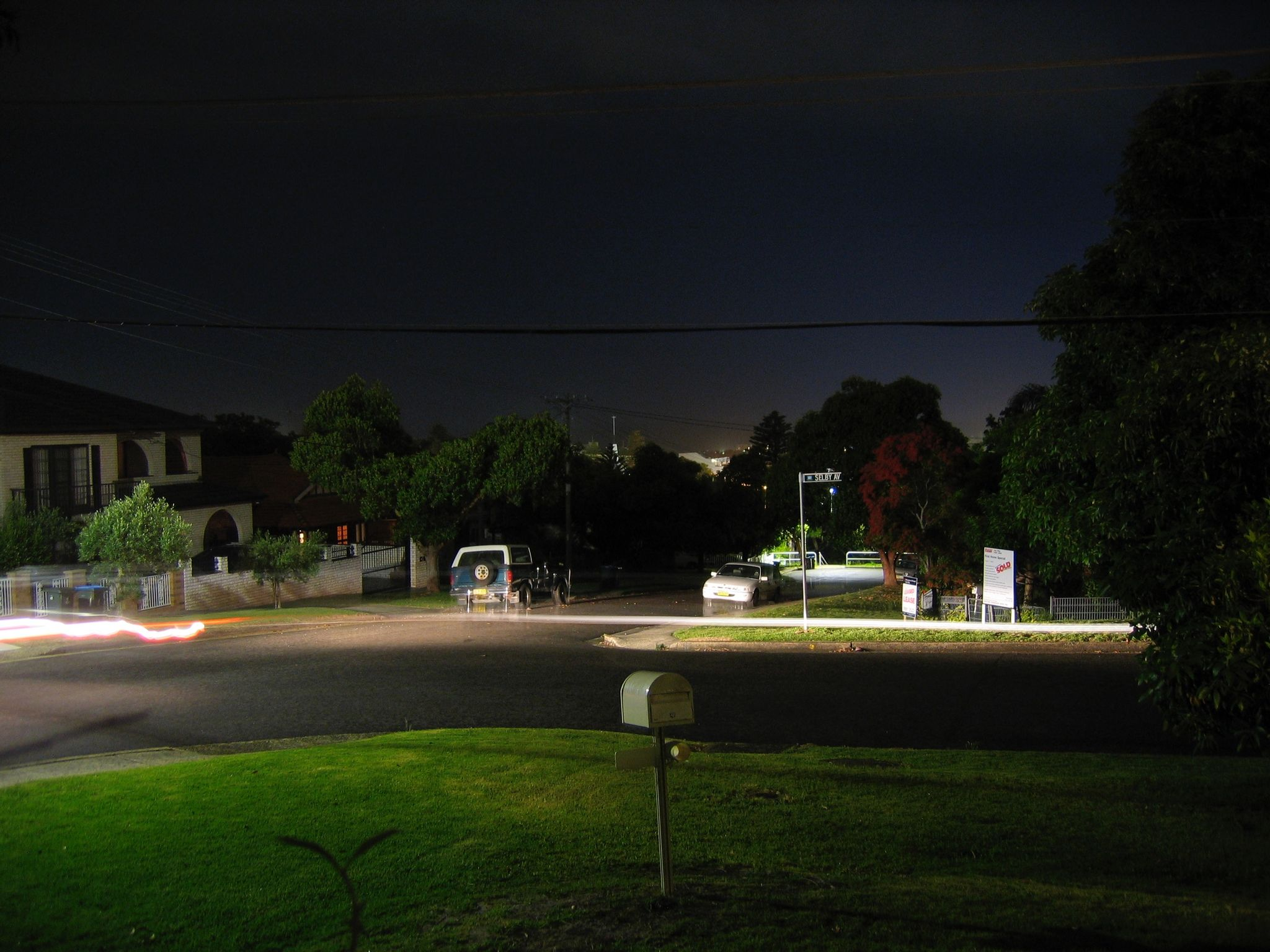 The same long-exposure vantage point from the previous photo except with the streak of a car's headlights going past.