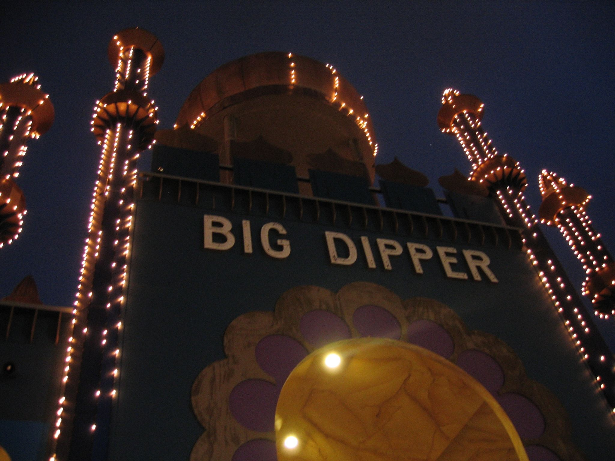 """A photo of the arched entrance to the """"Big Dipper"""" rollercoaster."""