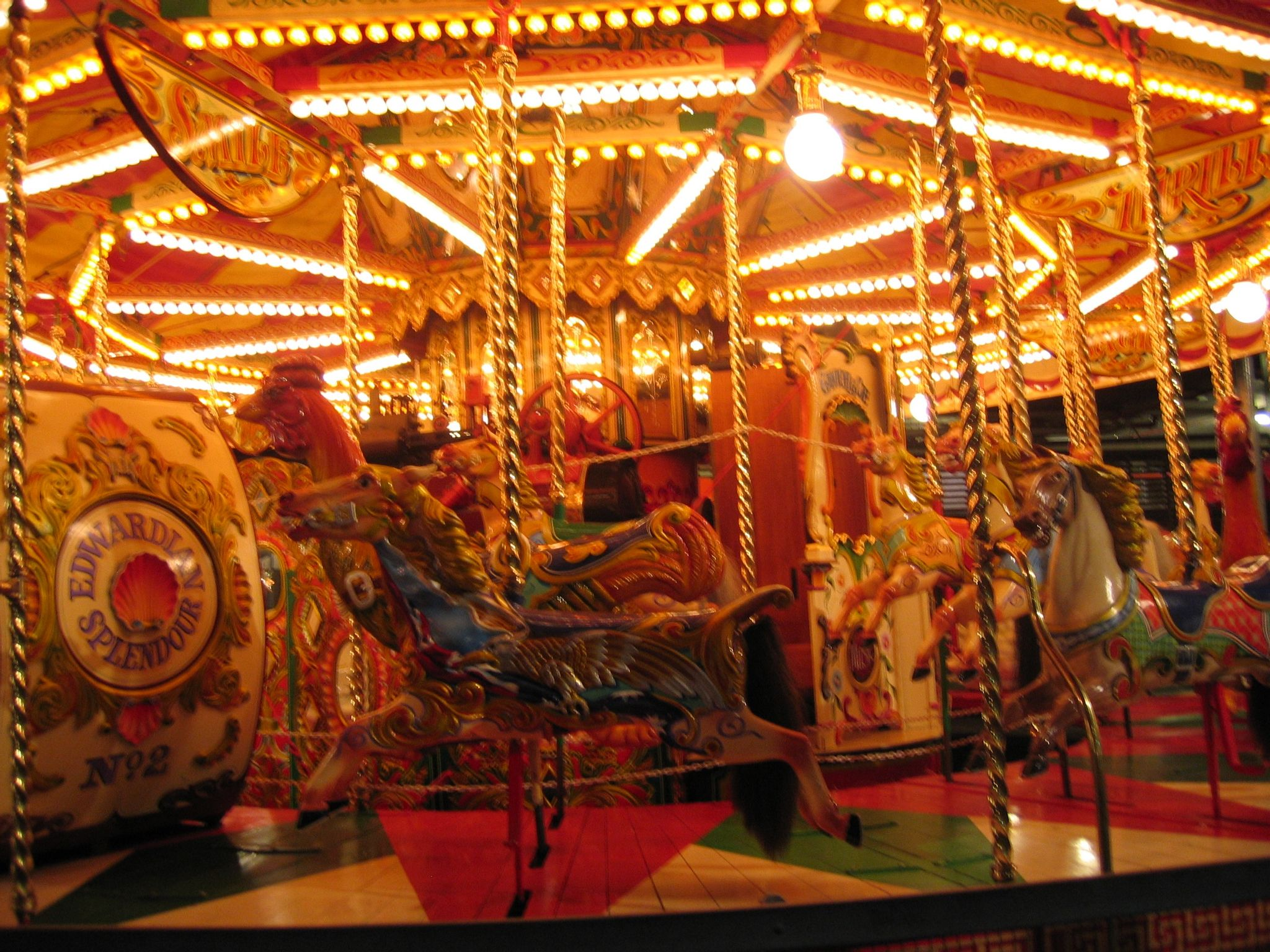 A photo of a very gaudy merry-go-round.