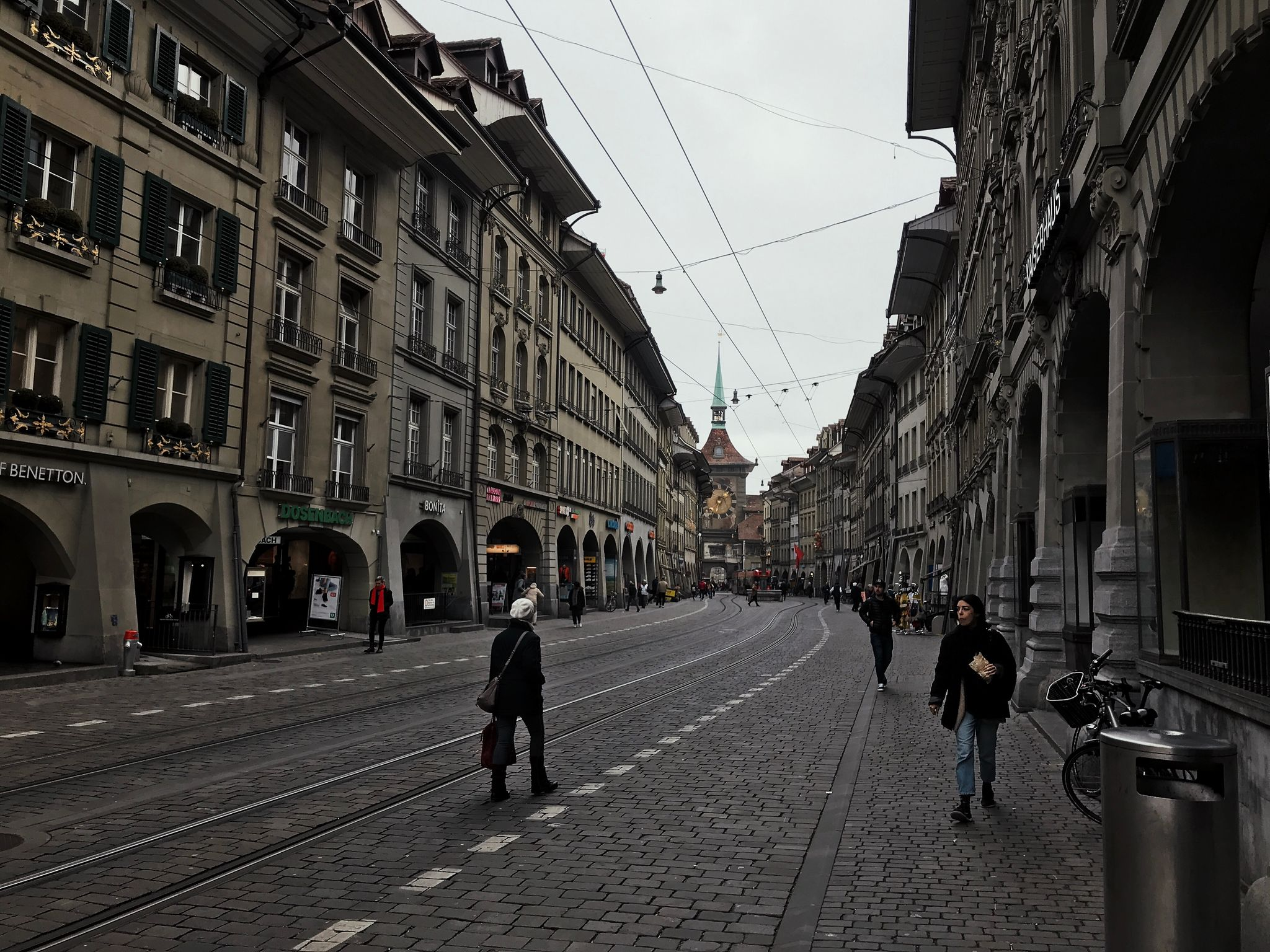 A photo looking down a cobblestone street in Bern.
