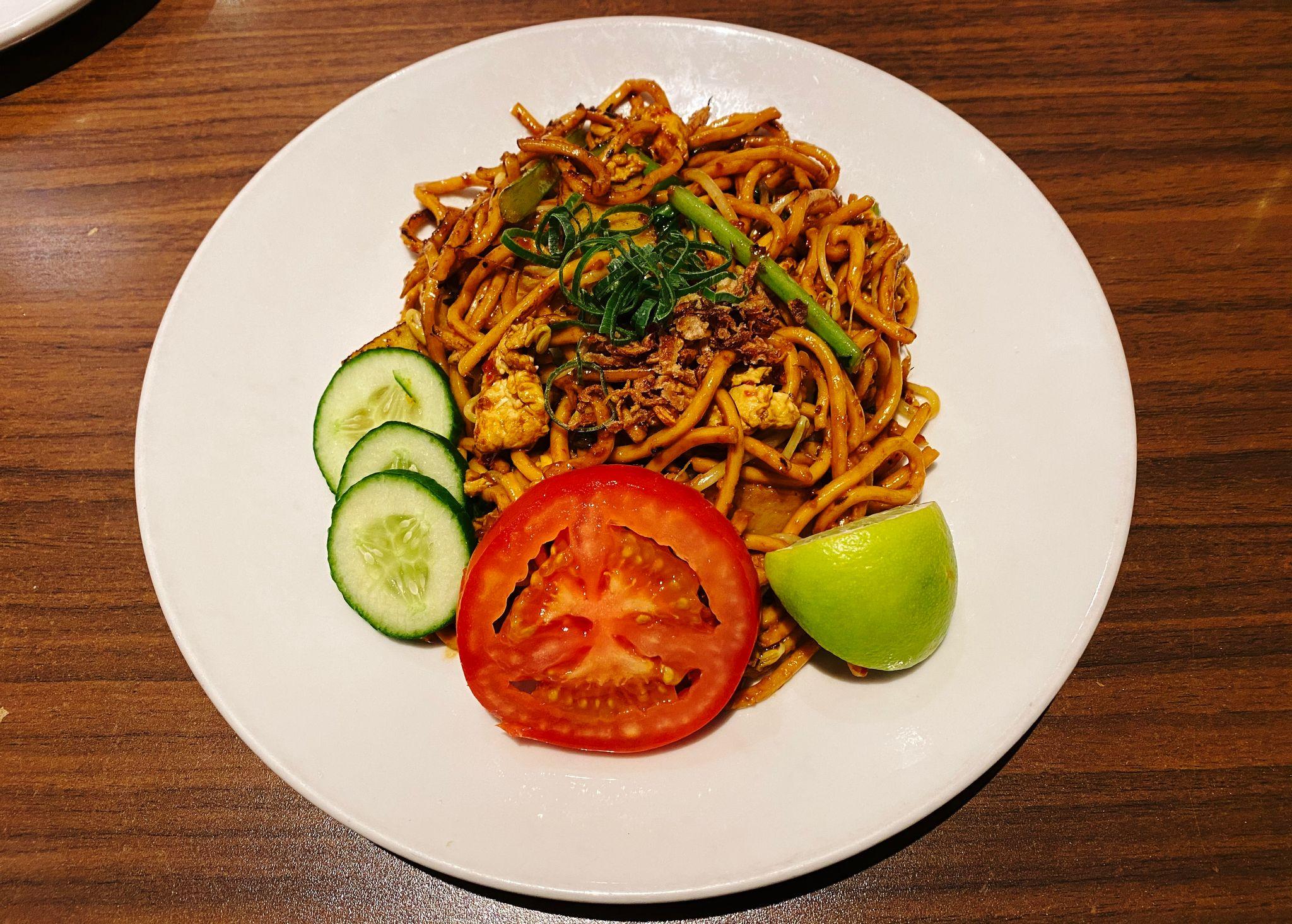 A photo of a plate of mee goreng.