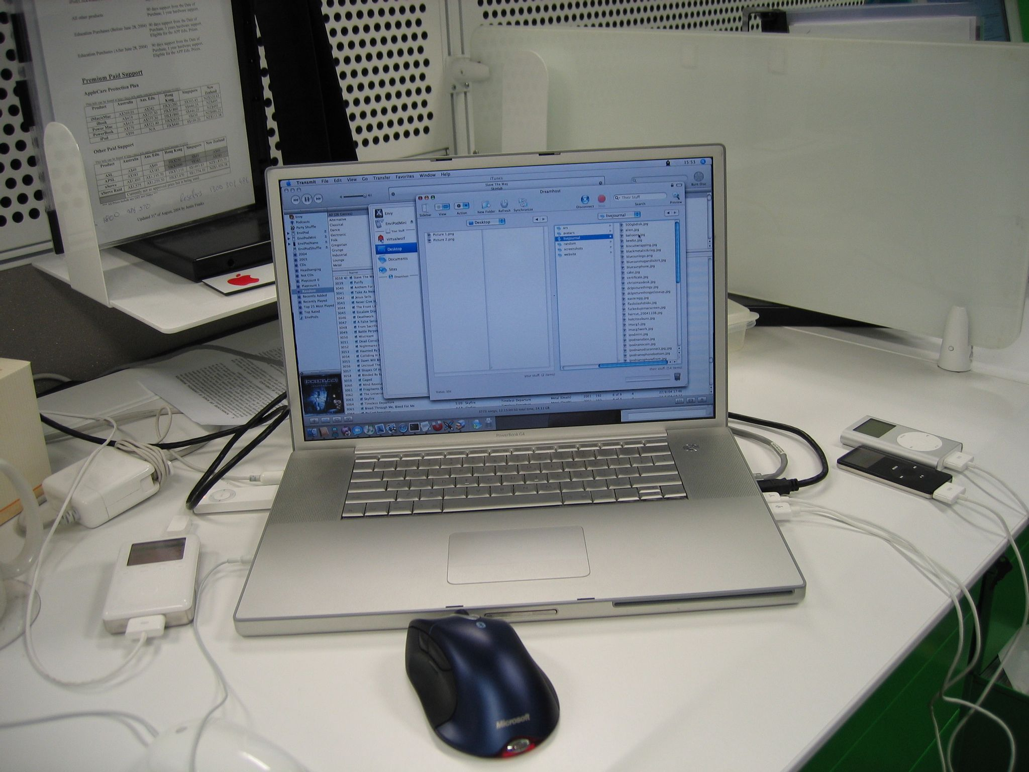 A photo of a PowerBook G4 with four iPods (a regular iPod, an iPod mini, an iPod nano, and an iPod shuffle) connected via USB to all four of its available USB ports.