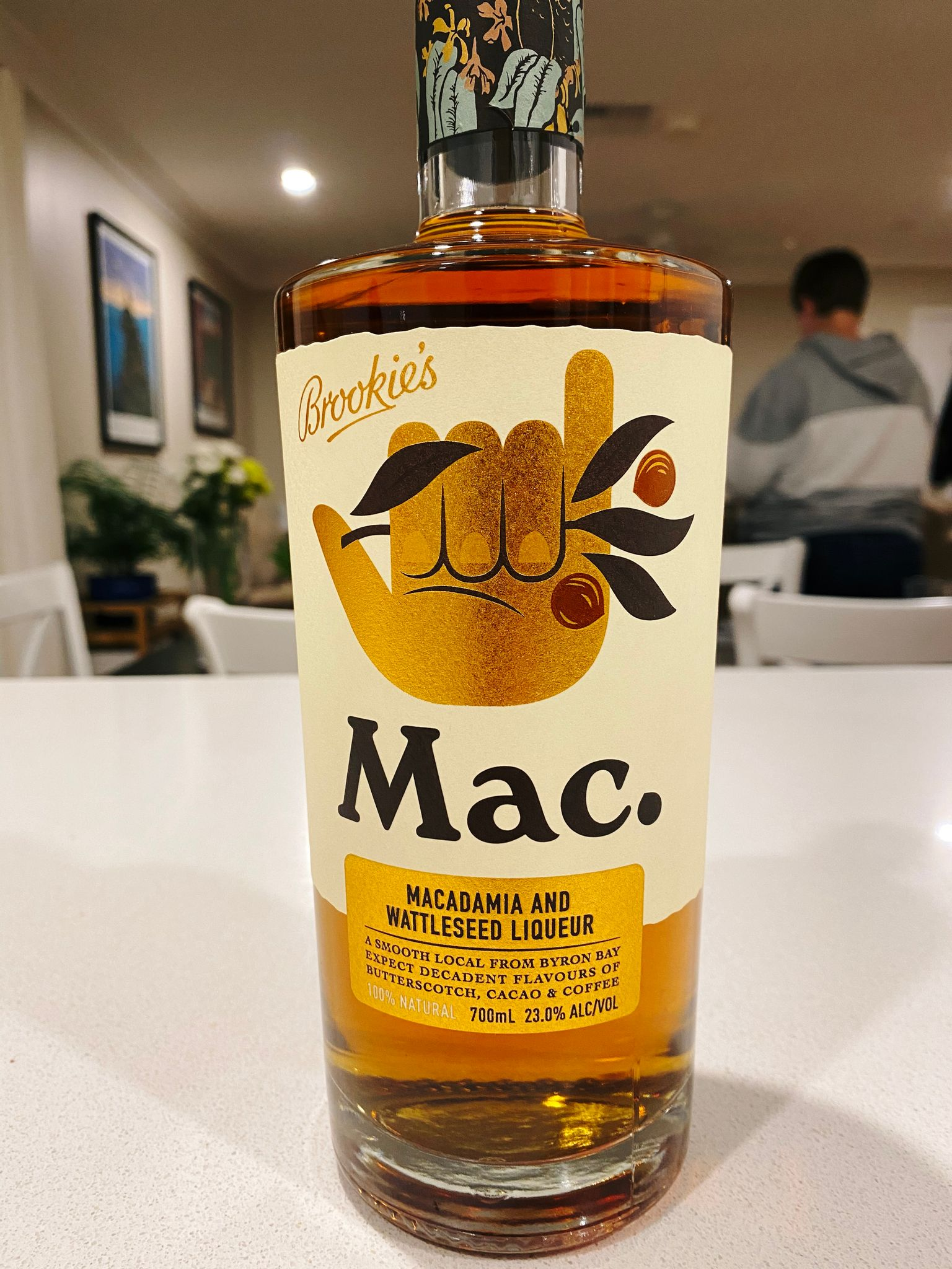 A photo of a bottle of macadamia and wattleseed liqueur.