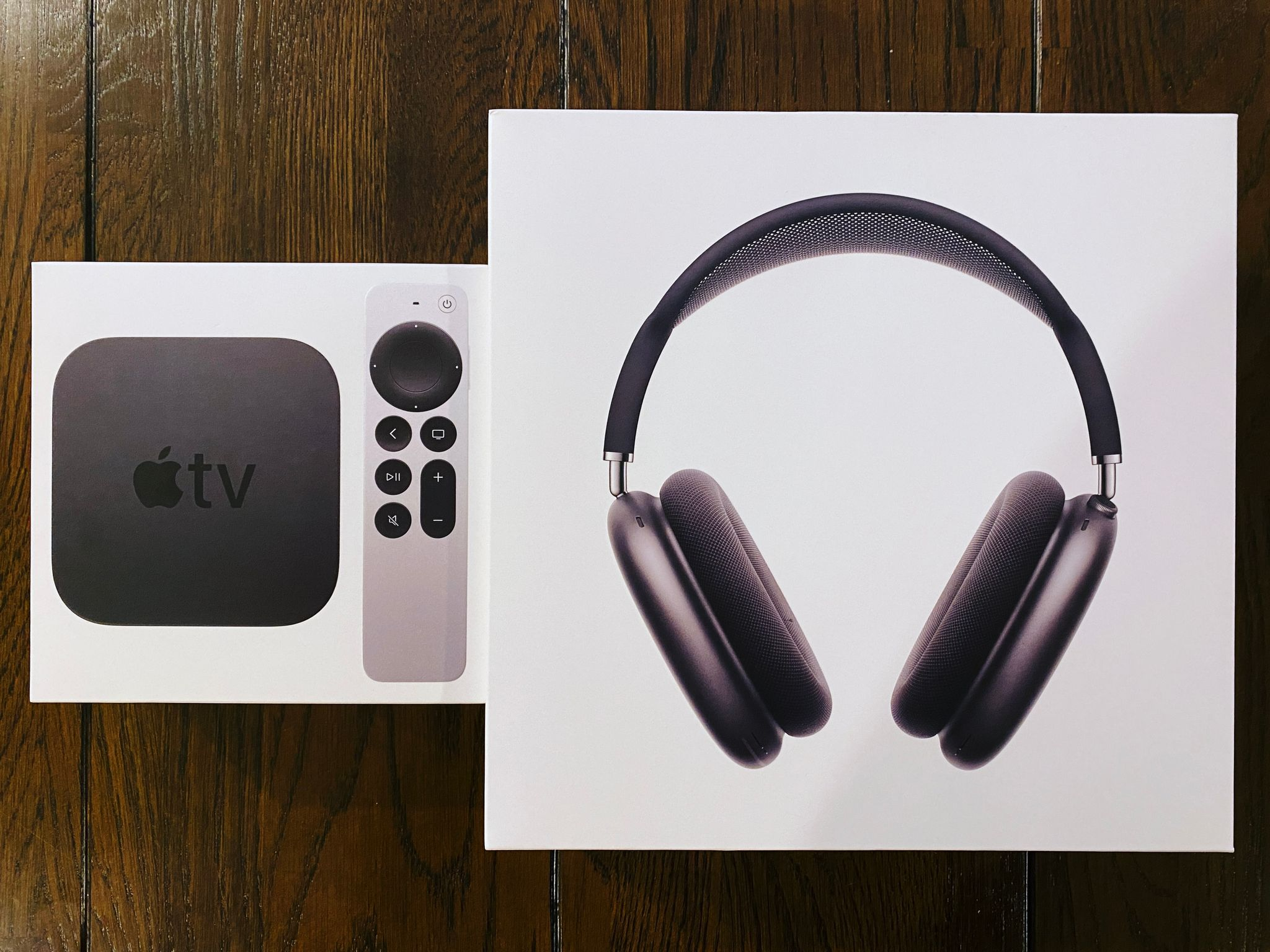 A photo of the box of an Apple TV 4K and AirPods Max in Space Grey.