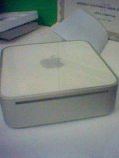 A photo of a G4 Mac mini sitting on a desk, not plugged into anything.