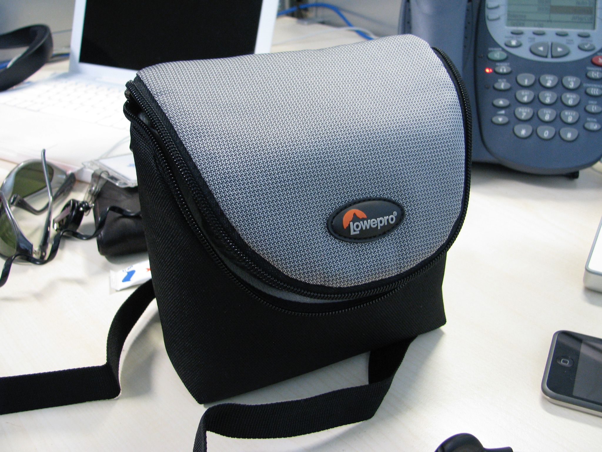 A photo of a small Lowepro brand shoulder-bag camera bag.