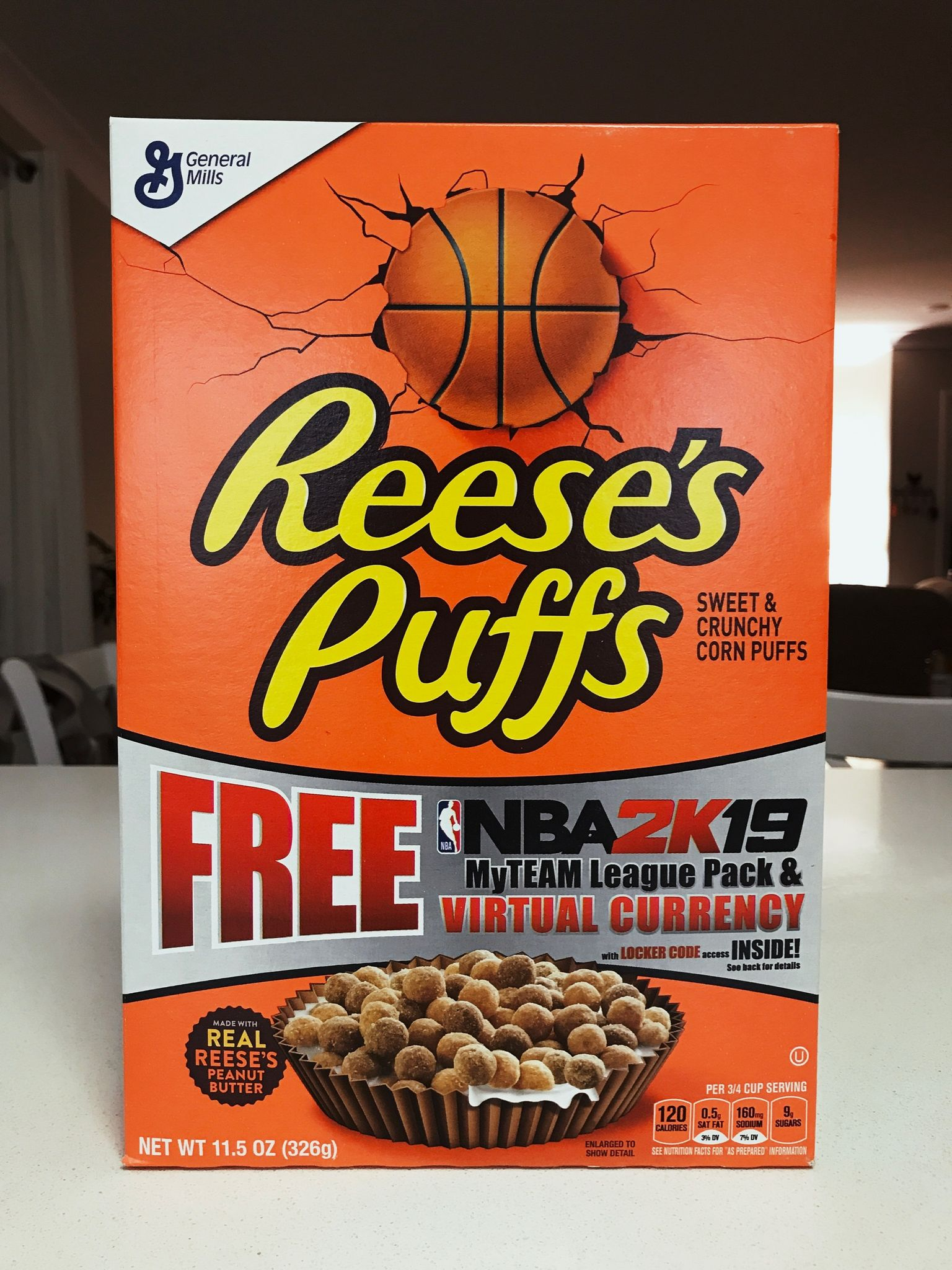 A box of Reece's Puffs peanut butter cereal.