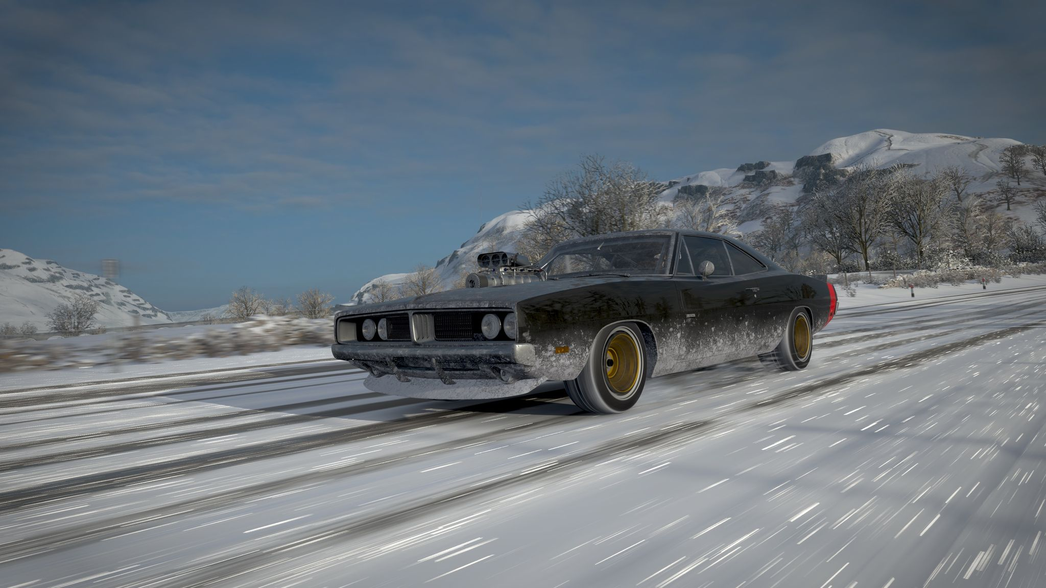 A screenshot from Forza Horizon 4 of a black American muscle car with the engine poking through the bonnet, driving down a snowy road.