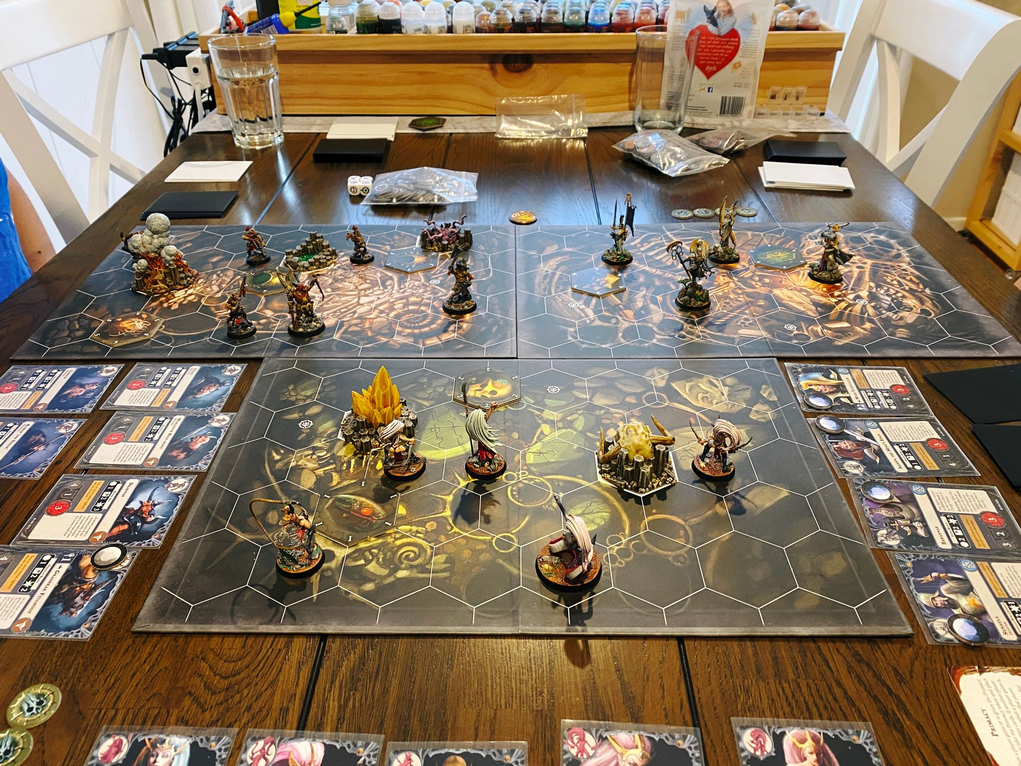 A photo of a three-player game of Warhammer Underworlds. Myari's Purifiers vs. Morgwaeth's Blade-coven vs. Grashrak's Despoilers. Kristina won with Myari's Purifiers.