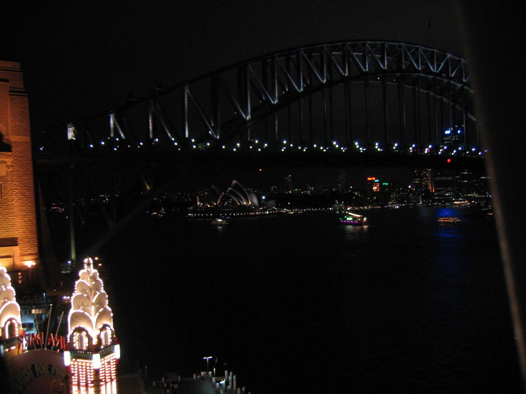 Another very dark photo of Sydney Harbour Bridge taken from atop a ferris wheel.